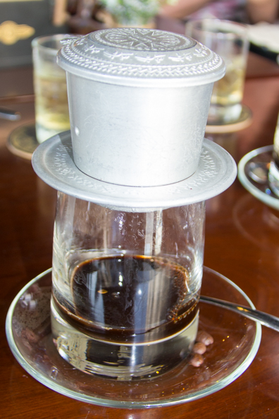 Vietnamese coffee perking in Trung Nguyen Legend coffee shop in Ho Chi Minh City in Vietnam