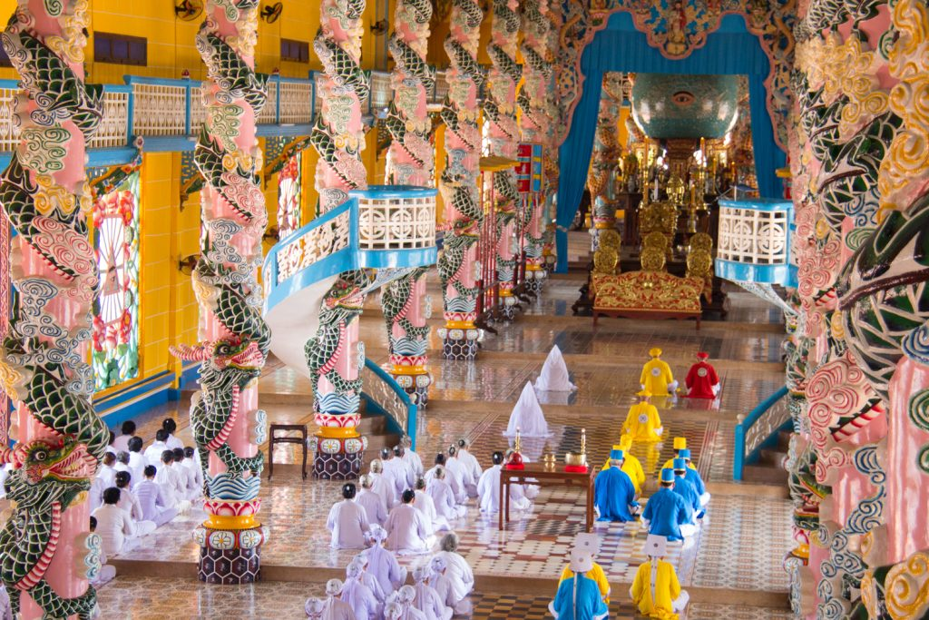 Noon ceremony at the Cao Dai Temple Divine Temple in Tay Ninh in Vietnam