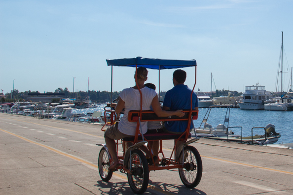 Cycling along the sea front of Umag on the Istrian Coast in Croatia
