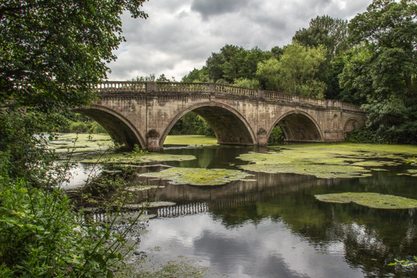 Clumber or Carburton Bridge in Clumber Park, in Sherwood Forest, Nottinghamshire in the UK