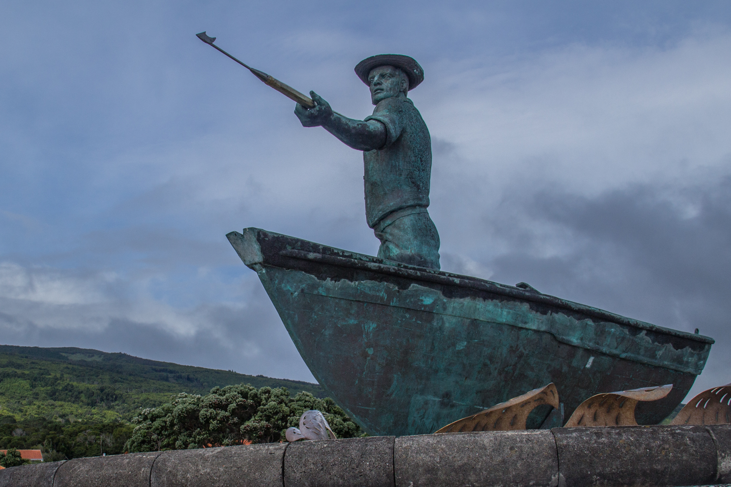 Monument of a whale hunter outside the Whaling Industry Museum on Pico Island in the Azores
