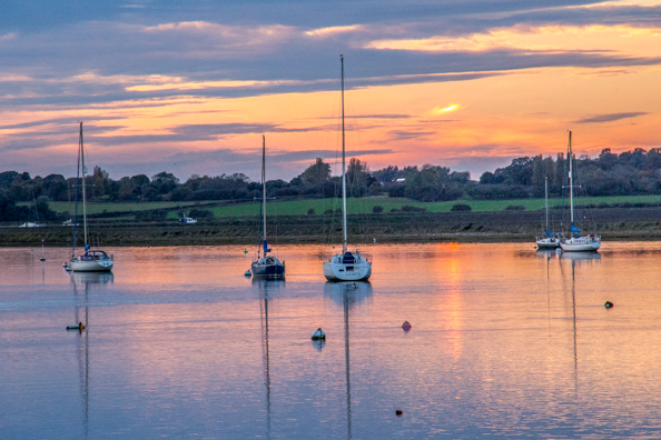 Sun setting over the River Alde in Aldeburgh, Suffolk