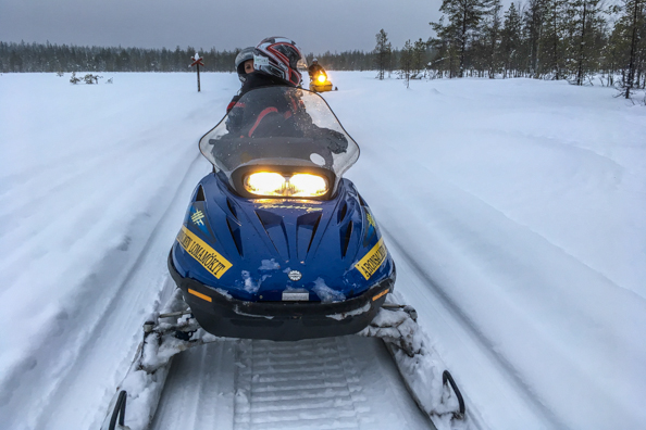 Snowmobile safari in the Wild Taiga in Finland